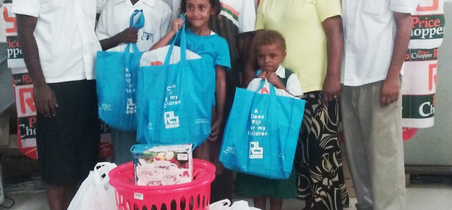 RB Patel Harbour Point Manager - Daniel Prasad and Assistant Manager - Noa giving out Survival Packs to this family from Lami